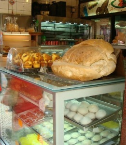 A large loaf of bread in a local bakery. Everything in excess is Macau's unofficial motto. Shows the Portuguese influence.