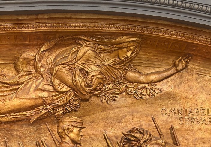 Detail from Saint-Gaudens beautiful monument to the 54th. If you look in the crook of the angel's arm, you'll see poppies.